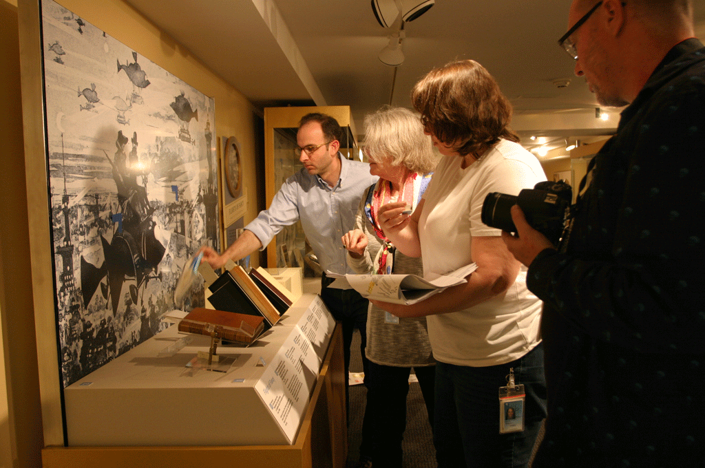 OEC staff and Smithsonian Libraries conservators arrange books for display.