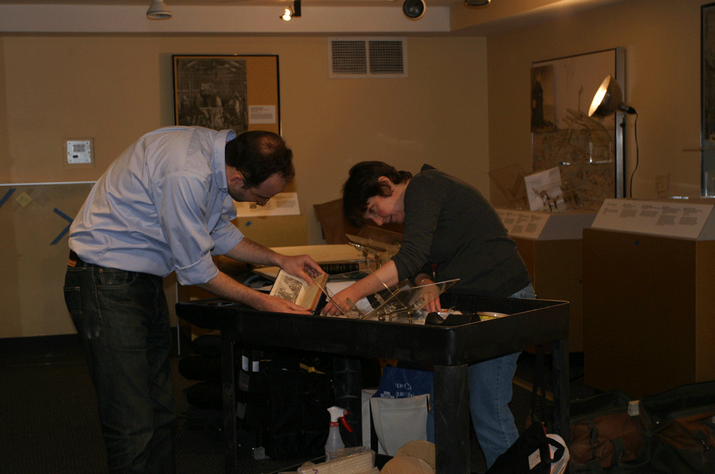 Conservators from Smithsonian Libraries prepare a book for the exhibit.