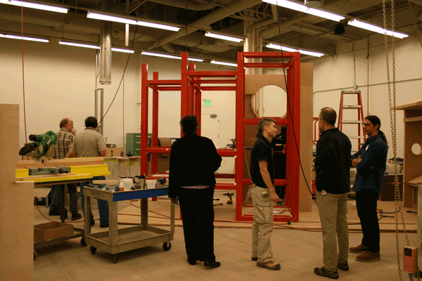 Fabricator and archival framer Jordan Tierney (third from right) and guests stand in front of portions of Wonderplace, which will be installed at the National Museum of American History in the coming weeks.