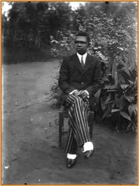 S.O. Alonge self-portrait, seated outside his Benin City studio, c. 1942.