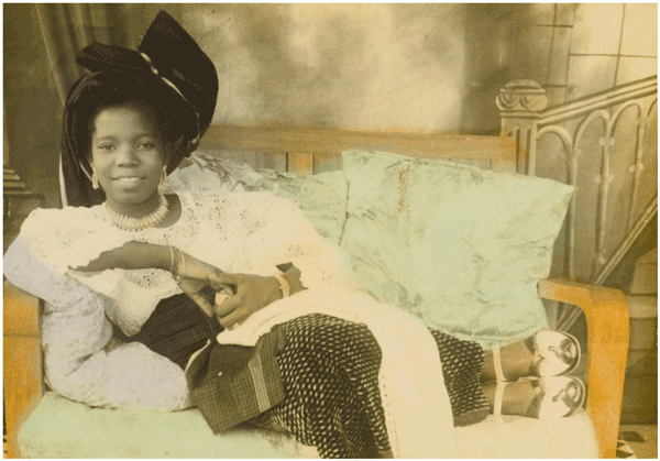 Madam Stella Gbingie at age 16. Benin City, Nigeria. Hand-colored photograph by Solomon Osagie Alonge, 1950.