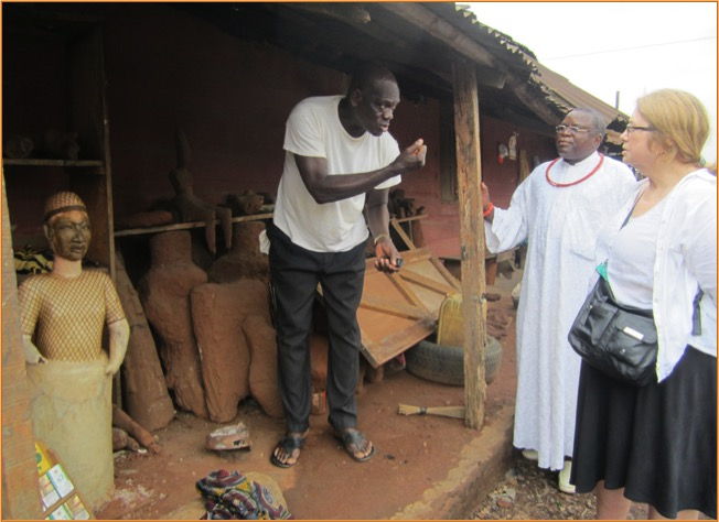Igun Street: Chief Ehanire and an artisan explaining the lost-wax bronze casting process. Photo by Amy Staples