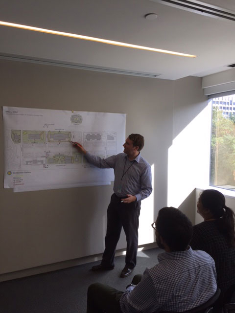 SIE exhibit developer/writer John Powell reviews a map of the proposed exhibits with the IMP team.