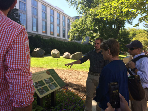 Horticulturist James Gagliardi leads SIE's team on a tour of the gardens.