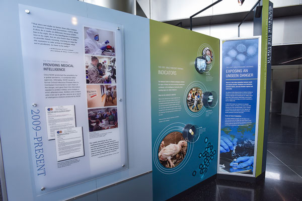 Three exhibition panels detailing NCMI's work regarding the H1N1 flu pandemic.