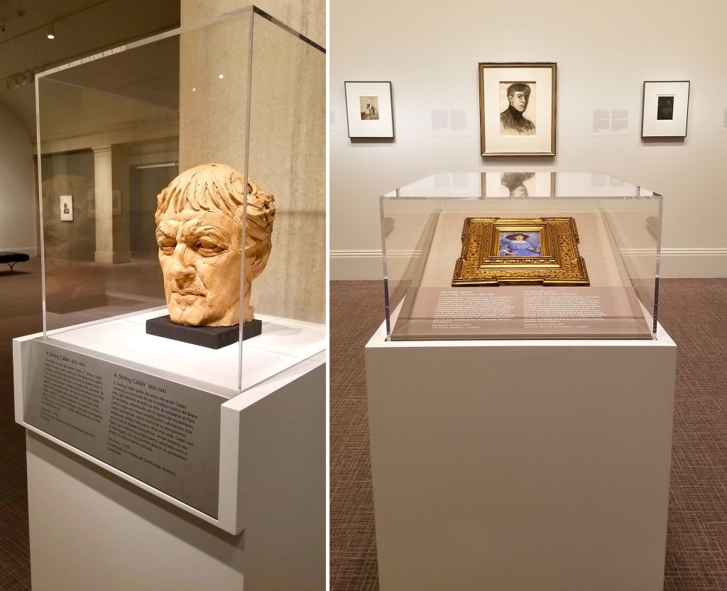 Two display cases: one containing the bust of a man's head; the other containing a small framed painting