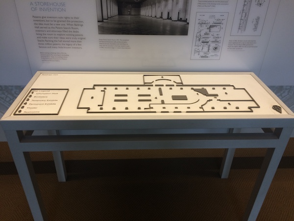 A table containing a raised-line floor plan showing the locations of exhibits at the White House Visitor Center