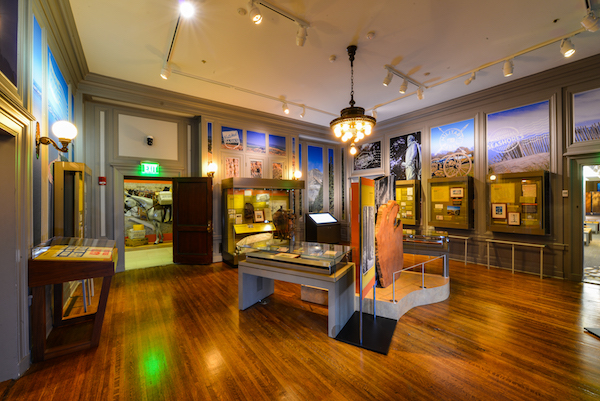 A gallery with display cases lining the walls and at the center of the room