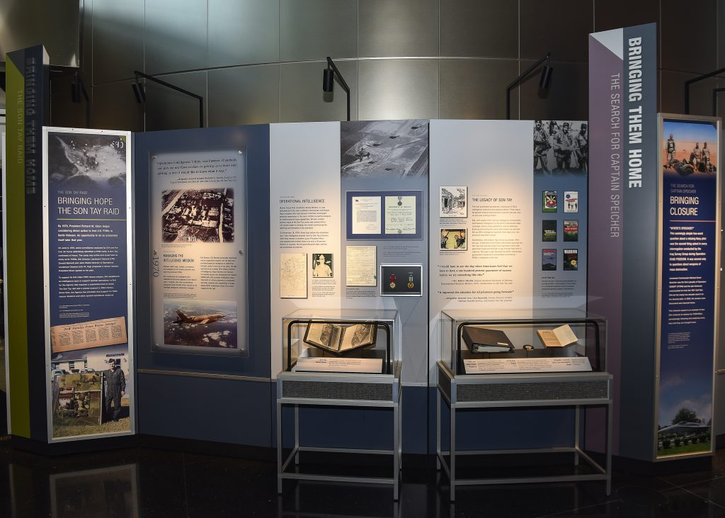 museum display with two cases and several panels