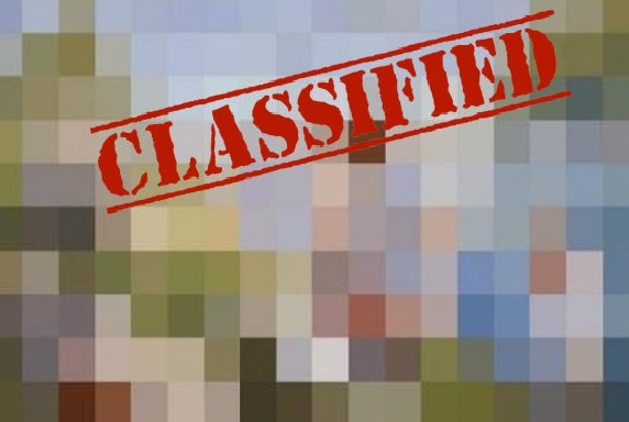 "pixelated photo with the word ""classified"" stamped on it"