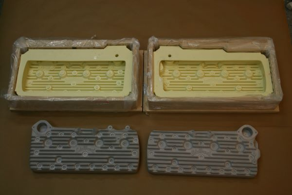 Two yellow rectangular molds pictured at top with two gray rectangular models below.